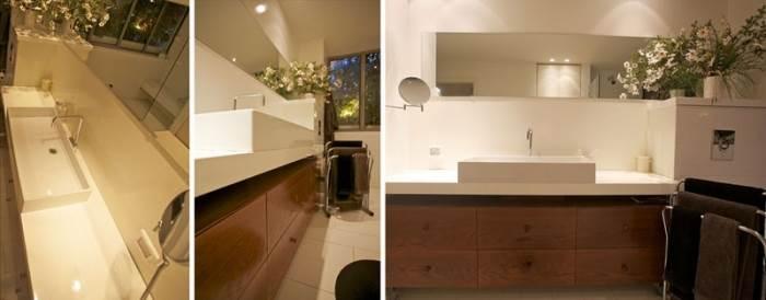 לא רק עץ בארונות, גם המשטח מתחת לכיור עשוי מעץ בצביעה אטומה (צילום: דרור כץ)