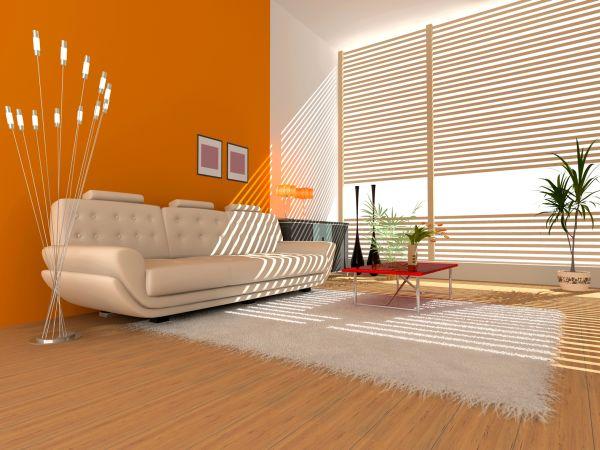 לא לפחד ללכת על גוונים לא שגרתיים: גוון כתום של נירלט בסלון הבית. צילום: יח