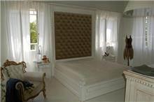 מיטה זוגית עם קפיטונז'