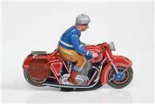 אופנוען צעצוע אדום - Fibers