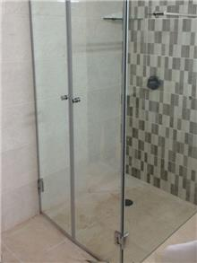 מקלחון עם דלתות כפולות - זאב זכוכית