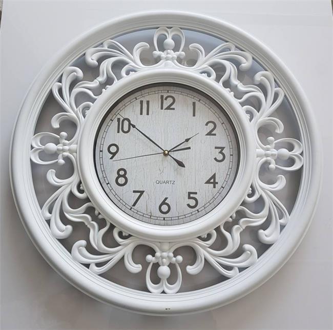 שעון קיר מסוגנן - עידן פרזול ודלתות בע''מ