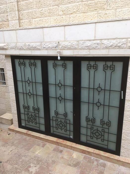 """דלתות כניסה בעיצוב מרהיב  - מסגרית הדודים בע""""מ"""