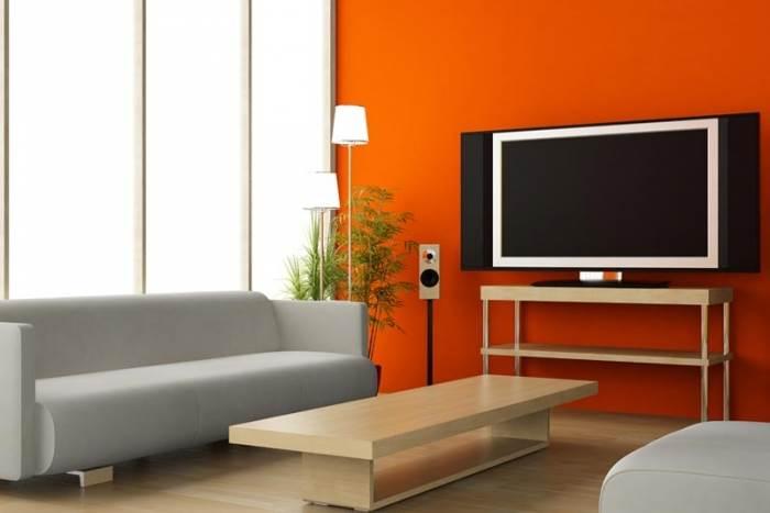 כמו בטבע כך בעיצוב, הכתום משמש להסוואה או להבלטה. אז מה בשבילכם? כתום בסלון בעיצוב נירלט (צילום: יח