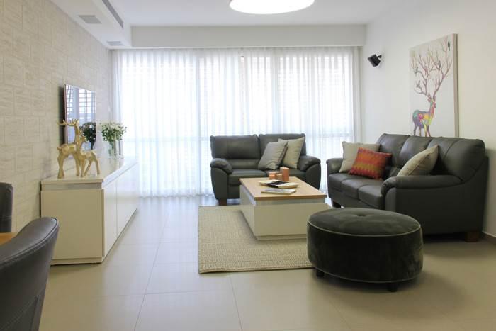 עיצוב בסגנון מינימליסטי ונגיעות של צבע באביזרים משלימים - דירה בעיצוב מגי דוידוב