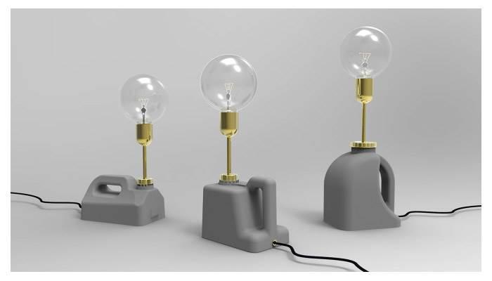 אלון ביטון. CONCRETE JERRY CANS. סדרה של שלושה גופי תאורה מבטון בשילוב מתכת מוזהבת, שעוסקים בחיבור בין עולם התעשייה והפלסטיקה לבין מלאכת קראפט ועבודת יד יחידנית. אלון נמנה בין שישה מעצבים מהטרמינל לעיצוב בבת ים, שיציגו במהלך היריד