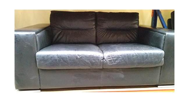 ספת עור דו מושבית שחורה - Fleamarket. צילום: יח