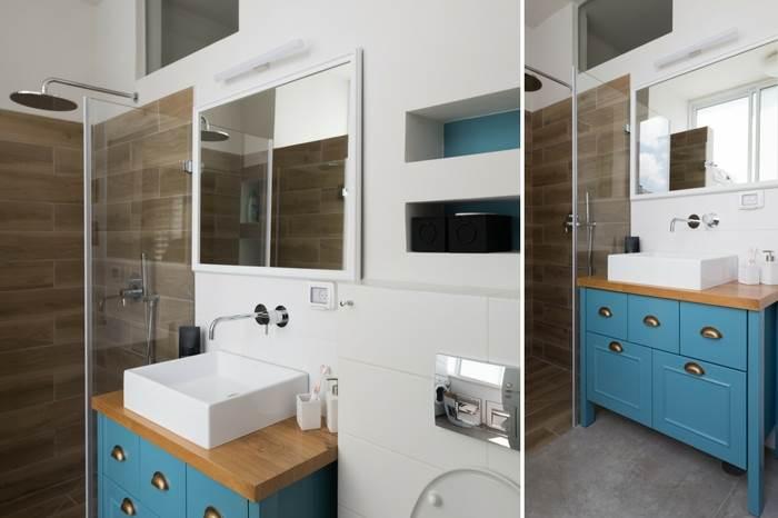 ידיות וחזיתות הארון מעניקות לחדר הרחצה של בעלי הבית, מראה רך וחם יותר | צילום: נמרוד סונדרס