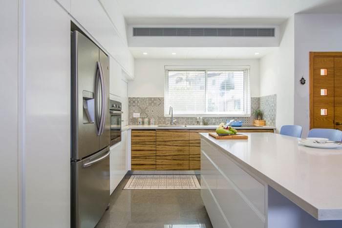 בקשת הדיירים שהמטבח יהיה פתוח, גדול ועם אי גדול | עיצוב פנים: אופיר זיו | צילום: עידן גור