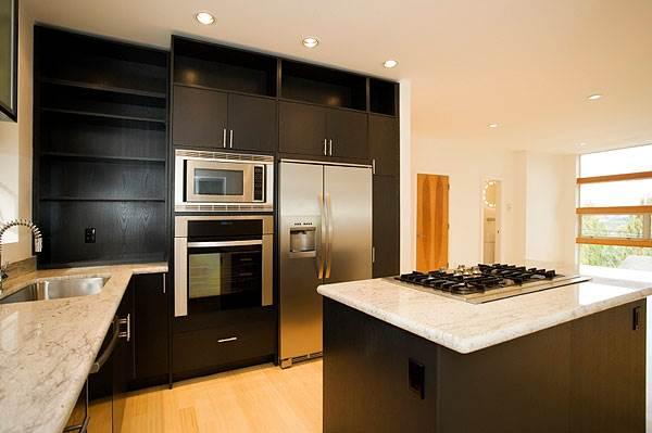 מערכת הבית החכם מאפשרת בלחיצת כפתור להפעיל את התנור ומכונת הכביסה<br/>(צילום: אילוסטרציה)