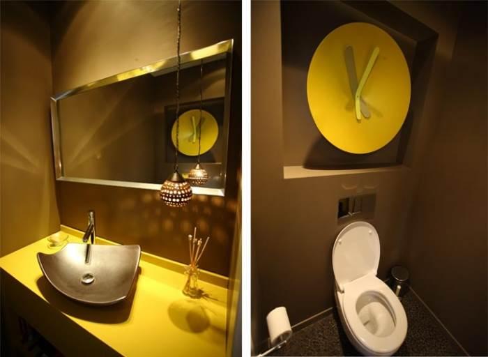 מראה מעוצב, מקורי ויוצא דופן, הכל בזכות השעון הצהוב שהיווה את ההשראה לכל העיצוב. שירותי אורחים (צילום: רודי אלמוג)