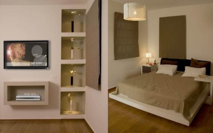 בית בנווה דורון: חדר שינה-סטודיו פרטים. נישות גבס להצבת חפצי נוי. צילום: אבישי פינקלשטיין