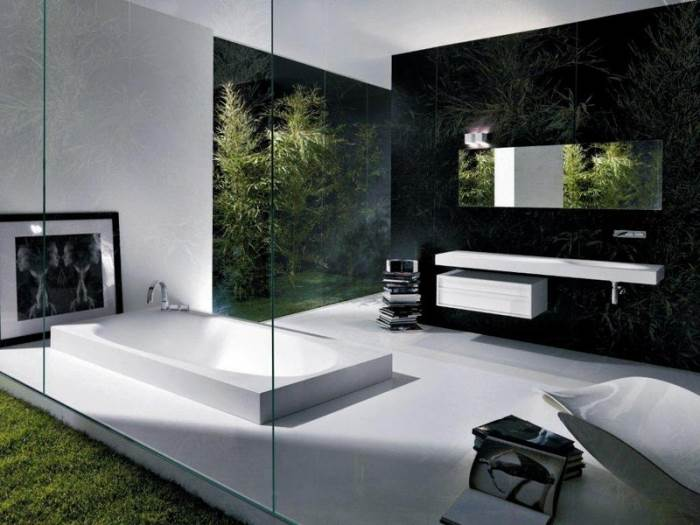 אמבטיה שקועה בתוך רצפה של מודי, מקולקצית פיס הוטל שהופכת את האמבט לבמה קטנה (צילום: יח