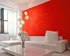סלון לבן מינימליסטי על רקע אדום בוהק