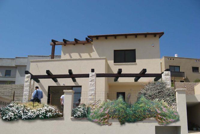 חזית בית פרטי המשדרת כפריות וטבעיות בחומר ובצורה-אדר' שגית גולדשמידט