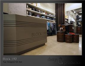 חנות קונספט, דיזנגוף תל אביב. חביות נפט חלודות המשמשות לתצוגת נעלי מעצבים. עוצב על ידי סטודיו ארטישוק.