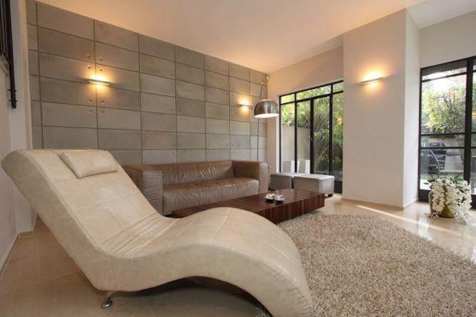 סלון מודרני בעיצוב מראה בטון. חגית רוזנברג, תכנון ועיצוב פנים
