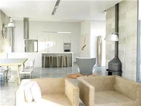 מטבח מודרני המשלב נירוסטה עם רצפת בטון, עיצוב יניב סולומון
