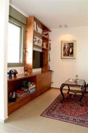 חדר משפחה בעיצוב מודרני. מיכלס - כספי אדריכלות ועיצוב פנים