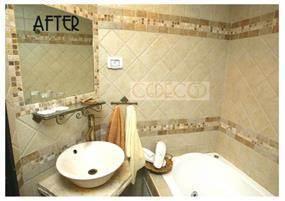 חדר אמבטיה בעיצוב קלאסי בשילוב אריחי פסיפס. עיצוב: גרונר קטרין CDGECO