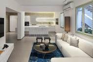 מבט אל חלל הסלון והמטבח בעיצוב מודרני ומנימסליסטי - BLV תכנון ועיצוב פנים - זהר בן לביא