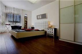חדר שינה בדירה לדוגמא