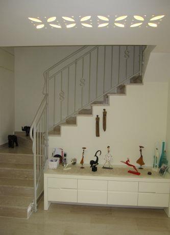 מבואת כניסה לבית בעיצוב מיכל גרינברג פוקס