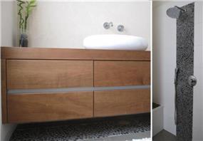 חלוקי נחל בחדר האמבטיה בעיצוב  מיכל גרינברג פוקס
