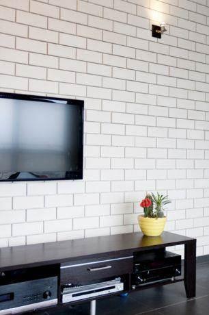קיר סלון מחופה בלבני סיליקט לבנות עם תאורת אווירה, KanDesign
