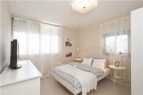 חדר שינה במראה קלאסי בעיצוב ותכנון של A&e design