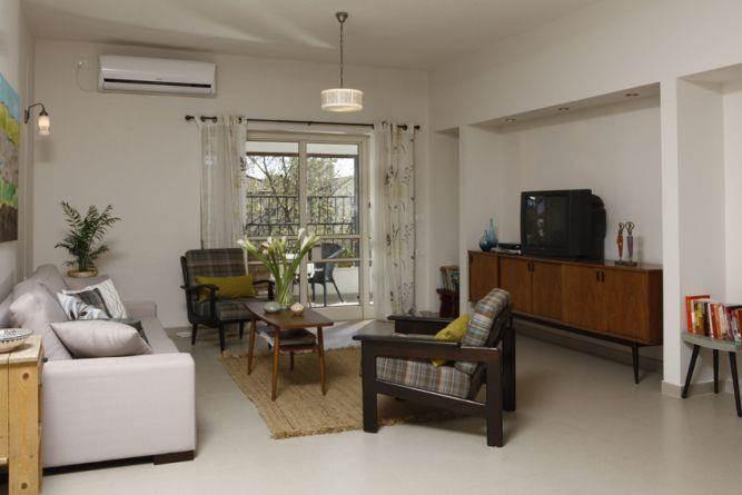 סלון מעוצב סגנון וינטאג' בתכנון ועיצוב של זוהר רוזנפלד