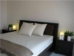 דירה ברח' בני רייך, נתניה. חדר שינה - סטודיו פרטים. צילום: לינור קמפאנו.