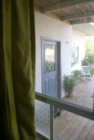 כניסה לבית, ניצני עוז - רונית תירוש-אדריכלות ועיצוב פנים