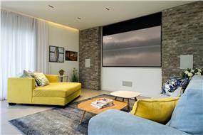 עיצוב נקי ומודרני לסלון בזווית מעניינת
