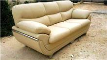 ספה מעוצבת בצבע קרם