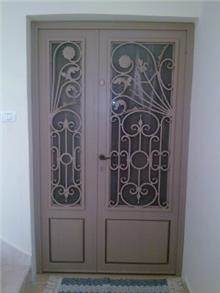 """דלת כניסה איכותית  - מסגרית הדודים בע""""מ"""
