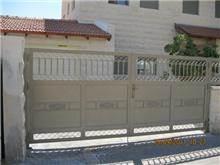 """שער לחניה - מסגרית הדודים בע""""מ"""