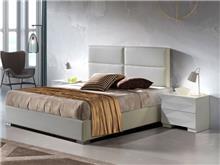 מיטה מרופדת בעיצוב מינימלי